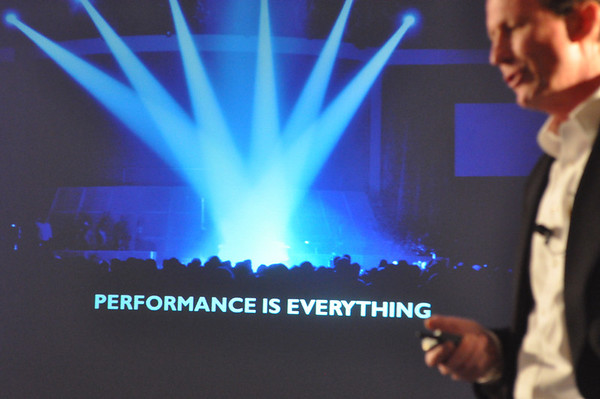 "Graphic showing D+M Group's new slogan, ""Performance is Everything"""